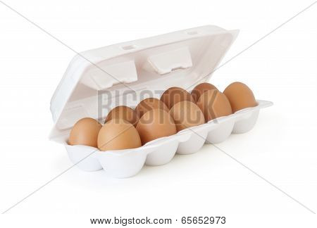 One dozen farm fresh eggs photographed on a white background.