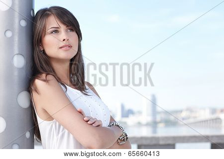 Closeup of thinking young woman outdoors