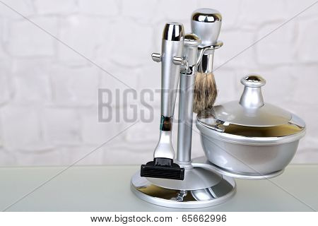 Male luxury shaving kit on shelf in bathroom