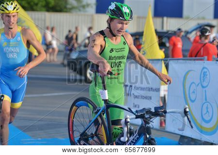 DNEPROPETROVSK, UKRAINE - MAY 24, 2014: Yegor Martynenko and Sergiy Kokhan of Ukraine leading after the second stage of ETU Sprint Triathlon European cup