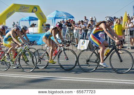 DNEPROPETROVSK, UKRAINE - MAY 24, 2014: Female athletes race on the cycling stage of ETU Sprint Triathlon European cup. It's the first time Triathlon European Cup take place in Ukraine