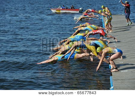 DNEPROPETROVSK, UKRAINE - MAY 24, 2014: Start of ETU Sprint Triathlon European cup in the group Elite Women. It's the first time Triathlon European Cup take place in Ukraine