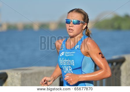 DNEPROPETROVSK, UKRAINE - MAY 24, 2014: Yuliya Yelistratova of Ukraine leading in the ETU Sprint Triathlon European cup. It's the first time Triathlon European Cup take place in Ukraine