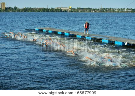 DNEPROPETROVSK, UKRAINE - MAY 24, 2014: Start of ETU Sprint Triathlon European cup in the group Elite Men. It's the first time Triathlon European Cup take place in Ukraine