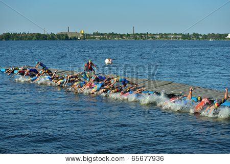DNEPROPETROVSK, UKRAINE - MAY 24, 2014: Start of ETU Sprint Triathlon European cup in the group Elite Men. It's the first time Triathlon European Cup take place in Ukraine