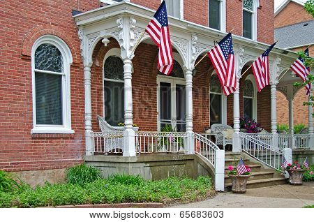 French Italianate house with flags