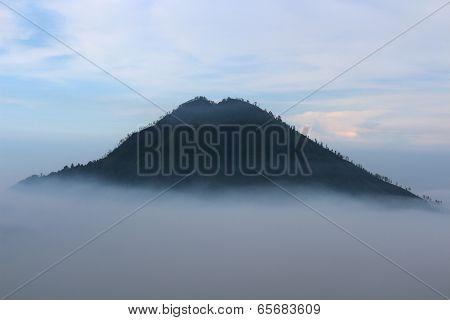 Mountain over cloud