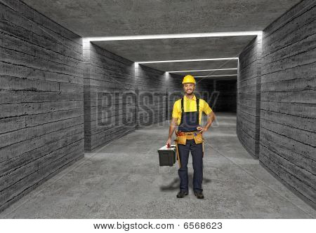 Construction Worker In Concrete Tunnel Background