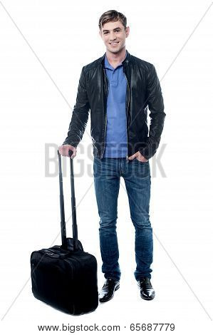 Smiling Young Man Going To Travel