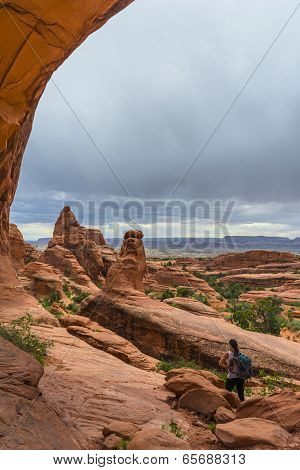 Female Hiker Under The Tower Arch Trail