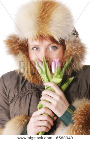 Redhead In Warm Clothes With Tulips