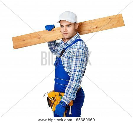 Young Carpenter Whis Wooden Plank