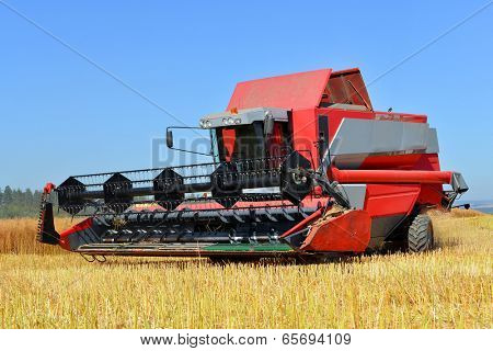 Chlumcany, Czech Republic, August 2, 2013   Combine harvester on a wheat field.