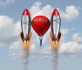 picture of acceleration  - Accelerated growth rate business concept as a businessman flying up with a hot air balloon helped by two rocket boosters as a career success metaphor for rising opportunity with new innovative competitive thinking - JPG