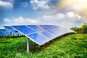 stock photo of farm landscape  - Landscape with solar energy field at summer day - JPG