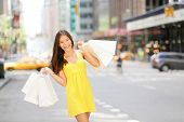 picture of multicultural  - Urban shopping woman in New York City street with yellow taxi cab - JPG