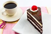image of pound cake  - Chocolate cake slice with red cherry fruit and coffee cup - JPG