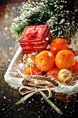 image of gift basket  - Mandarins in basket with Gift and Christmas tree branch - JPG