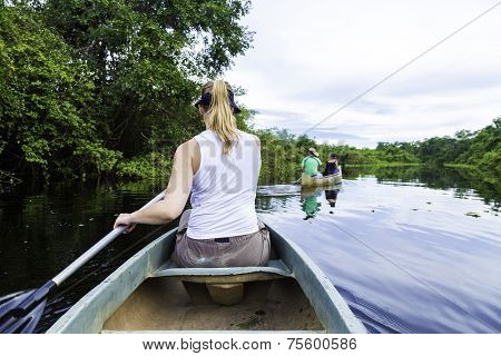 Woman riding canoe in Pantanal River, Brazil