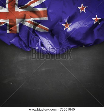 New Zealand waving flag on blackboard