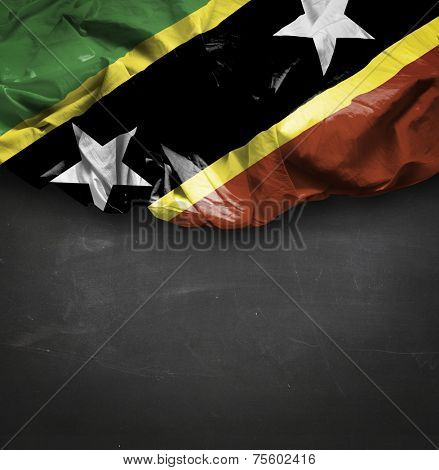 Saint Kitts and Nevis waving flag on blackboard
