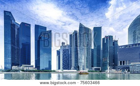 SINGAPORE - CIRCA MAY 2014: Urban landscape of Singapore. Skyline and modern skyscrapers of business district Marina Bay Sands at most financial developing Asian city state.