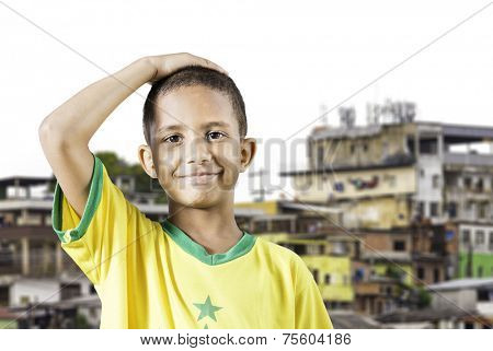 Brazilian little boy putting his hand on his head in Brazil