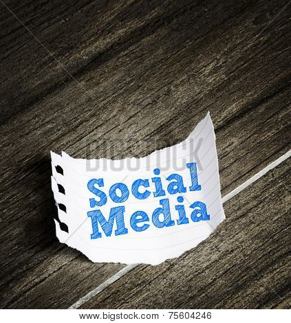 Social Media written on a paper on the wood background