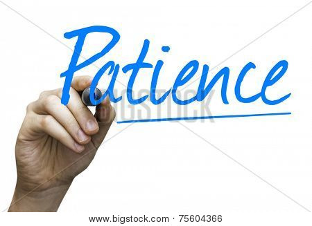 Patience hand writing with a blue mark on a transparent board