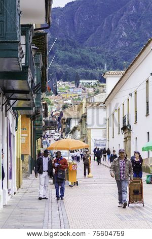 BOGOTA, COLOMBIA - CIRCA NOVEMBER 2013: People walking in Candelaria Area in Bogota, Colombia. La Candelaria the historic center of Bogota. Colombia's capital city was founded here in 1538.