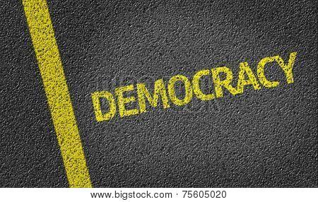 Democracy written on the road