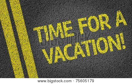 Time for a Vacation written on the road