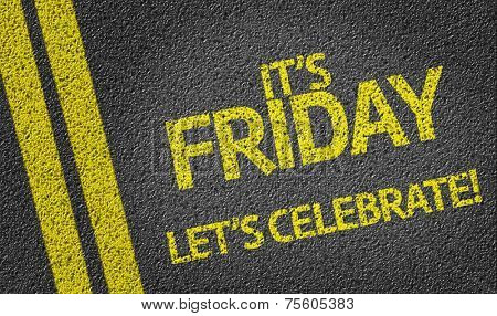 It's Friday, Let's Celebrate! written on the road