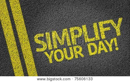 Simplify Your Day written on the road