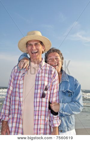 Laughing Mature Couple At The Beach