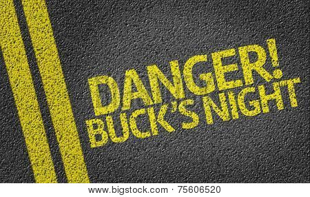 Danger! Buck's Night written on the road