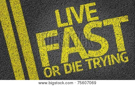 Live Fast or Die Trying written on the road