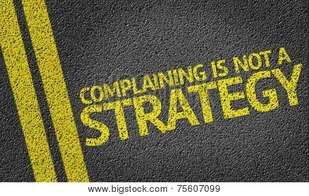 Complaining is not a Strategy written on the road