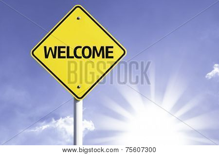 Welcome road sign with sun background