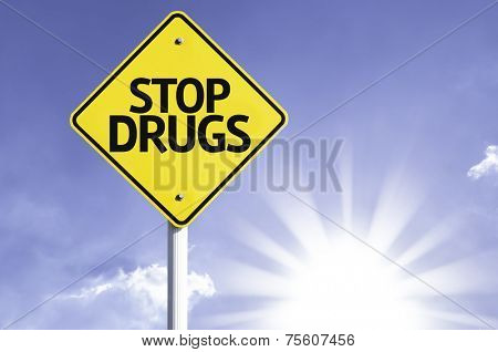 Stop Drugs road sign with sun background