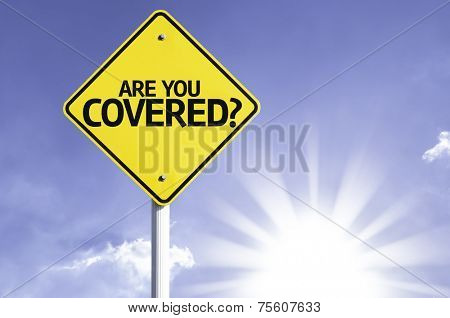 Are you Covered? road sign with sun background