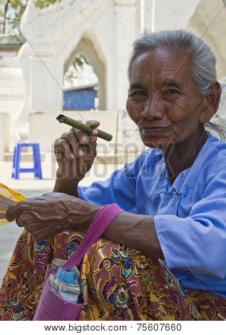 Old Asiatic Woman Smoking