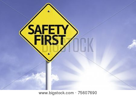 Safety First road sign with sun background