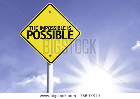 The Impossible is Possible road sign with sun background