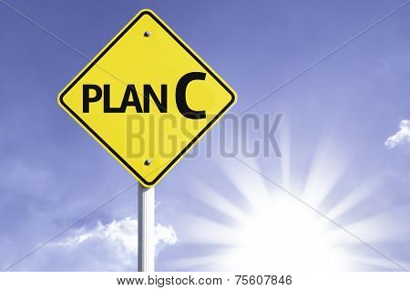 Plan C road sign with sun background