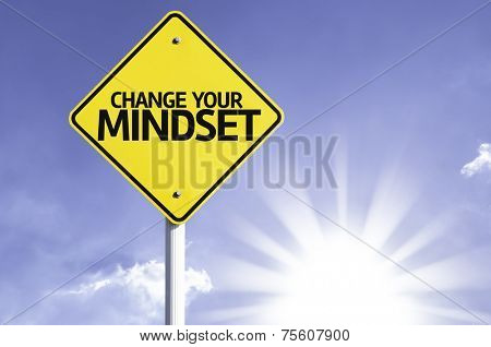 Change your Mindset road sign with sun background