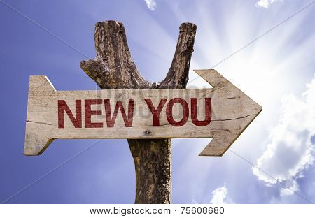 New You wooden sign on a beautiful day