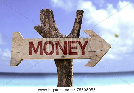 Money wooden sign with a beach on background