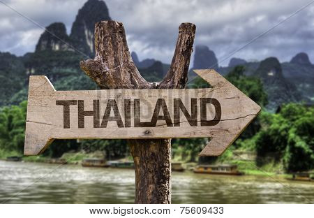 Thailand wooden sign with a forest background