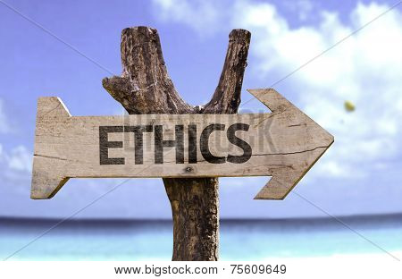 Ethics wooden sign with a beach on background